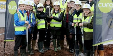 Schoolchildren bury time capsule in Midsomer Norton