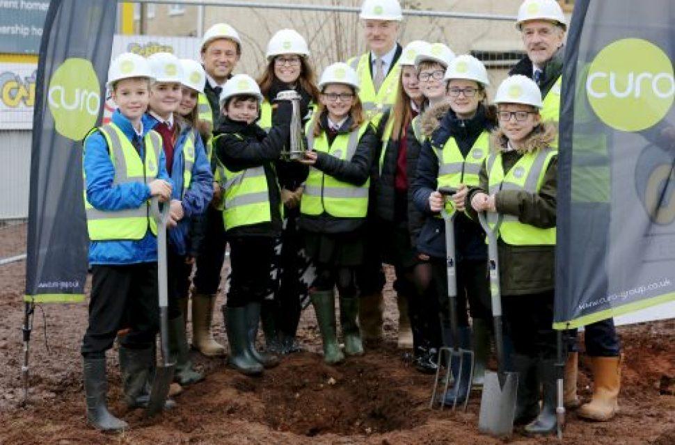 Schoolchildren bury time capsule in Midsomer Norton