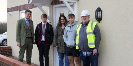 Families get the best present as they move into new homes in time for Christmas
